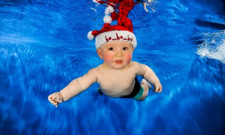 Baby swimming in winter
