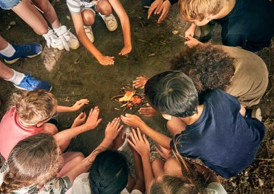 group-of-young-people-building-a-fire