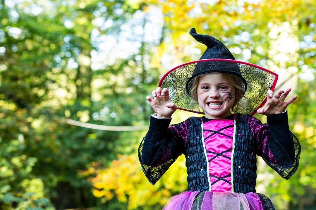 Girl dressed up as a witch