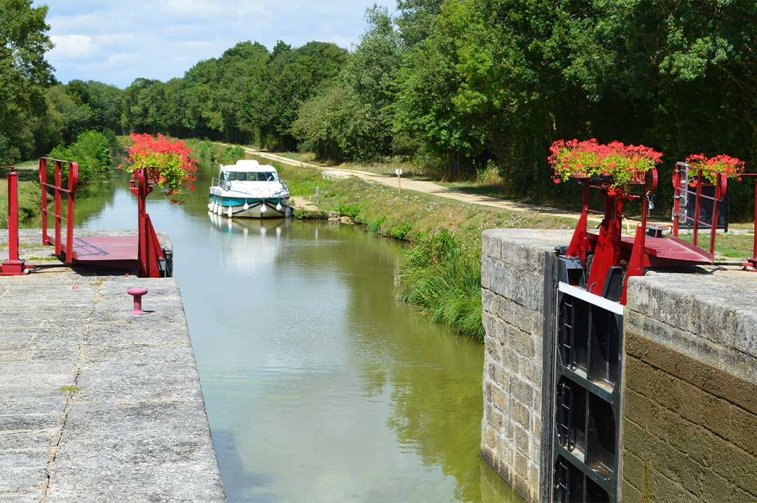 canal boat parked by a lock