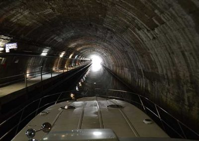 Boat passing through a tunnel