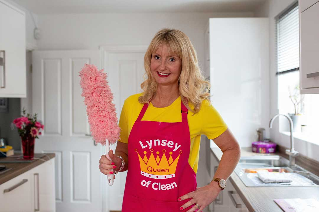 Lynsey Queen of clean with feather duster